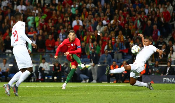 PORTO, PORTUGAL - JUNE 05:   Cristiano Ronaldo of Portugal (7) scores his team's third goal and completes his hat trick during the UEFA Nations League Semi-Final match between Portugal and Switzerland at Estadio do Dragao on June 05, 2019 in Porto, Portugal. (Photo by Jan Kruger/Getty Images)